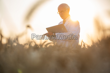 man doing research on genetically modified
