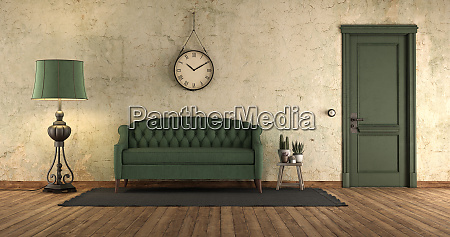 grunge interior with green sofa and