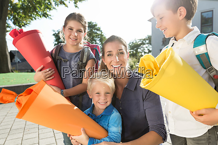 woman and kids at enrolment day