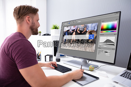 designer editing photo on computer