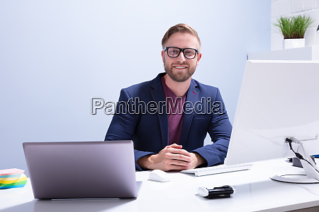 young businessman sitting in front of