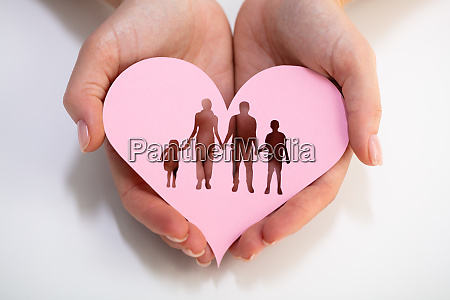 persons hand holding family cut out