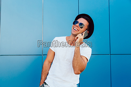 stylish man having pleasant phone conversation
