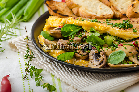 omelet with mushrooms lambs lettuce herbs