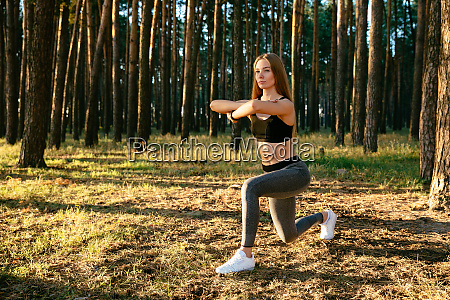 sportive girl stretching exercises outdoors