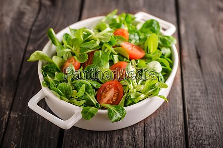 lamb lettuce salad tomatoes and herbs