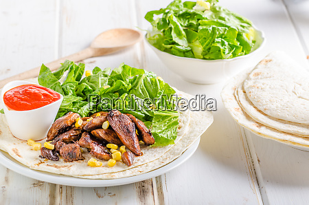 chicken teriyaki salad on tortilla