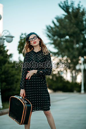 young woman in vintage black polka