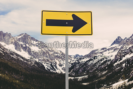 directional arrow sign in a snow