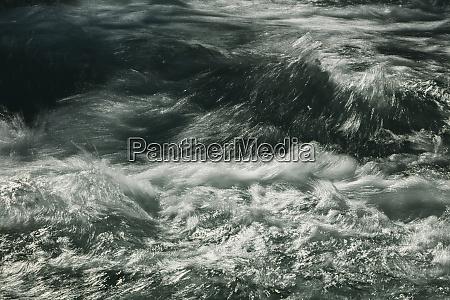 detail of rushing river water