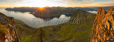 sun over the mountains on senja
