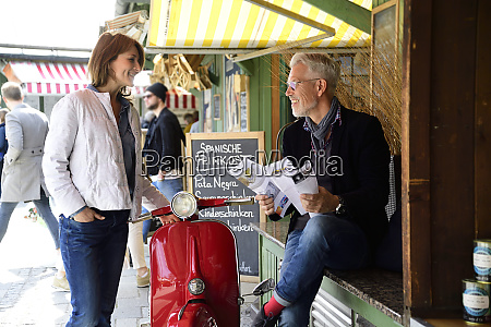 mature couple meeting at the market
