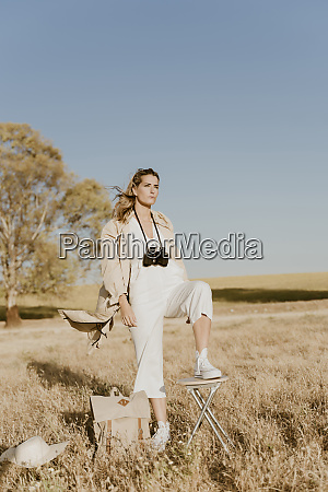 female traveller with binoculars