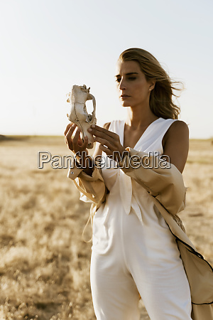 female traveller looking at skull