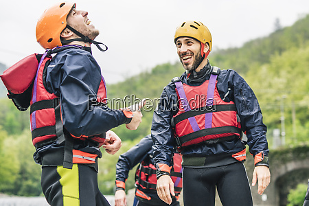 laughing friends in protective wear at