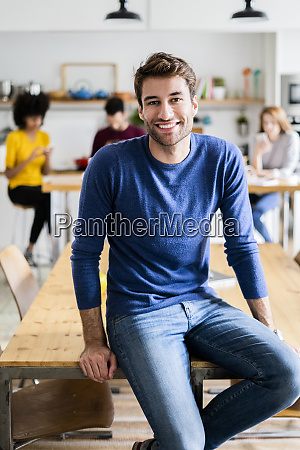 portrait of smiling man at dining