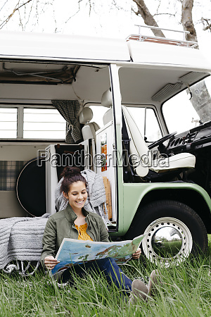 young woman studying map sitting in