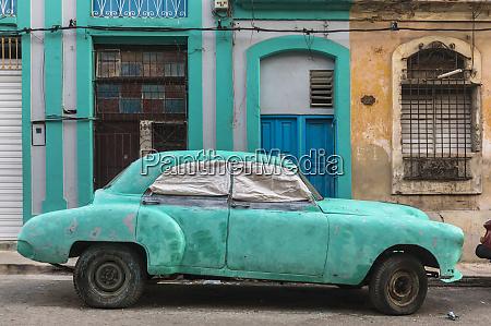 parked damaged vintage car havana cuba
