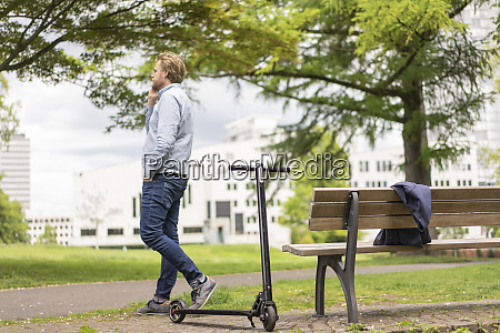businessman with e scooter on the