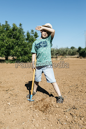 young gardener drying the sweat of