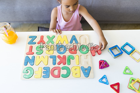 girl playing with alphabet learning game