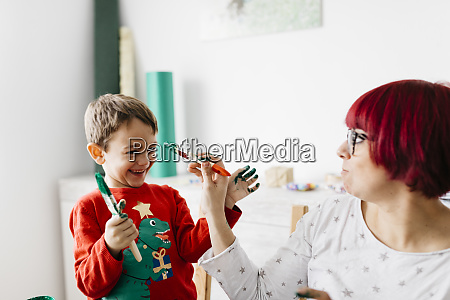 mother and son having fun while