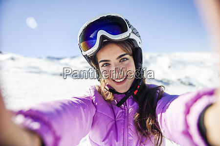 selfie, of, young, woman, in, ski - 27115977