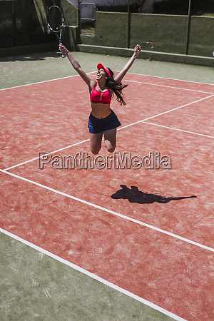 excited female tennis player cheering on