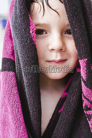 portrait of wet little boy with