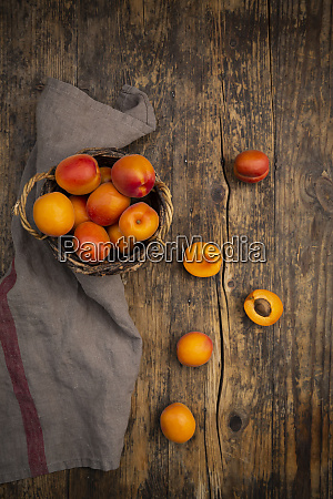 apricots in basket on dark wood
