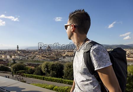 man enjoying the view of florence