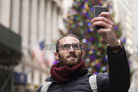 portrait of tourist taking selfie with