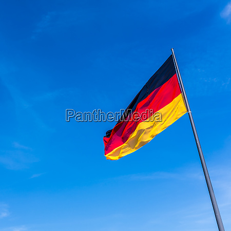 german flag against blue sky