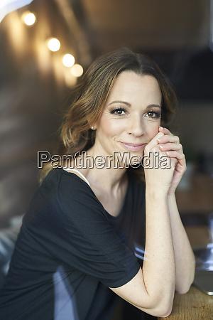 portrait of smiling brunette woman sitting