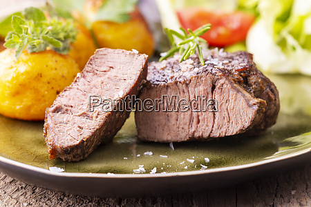 grilled juicy steak on a plate