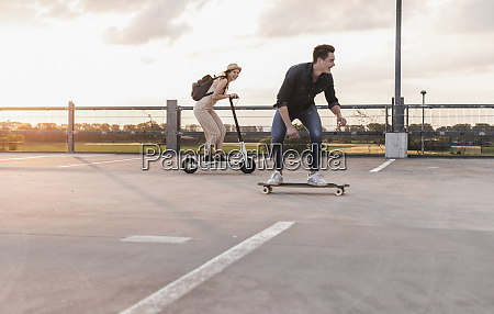 young man and woman riding on