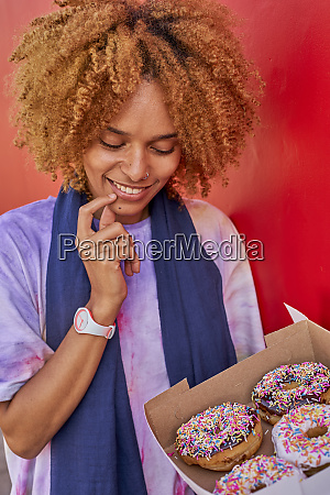 woman deciding which donut to choose