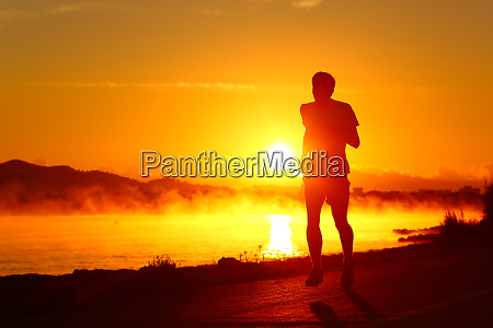 runner silhouette running at sunset on