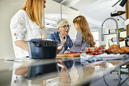 mother daughter and grandmother having fun