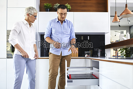 man and mature woman talking in