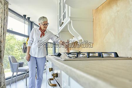 mature woman in a kitchen furniture
