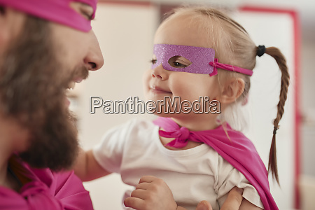 father and daughter playing super hero