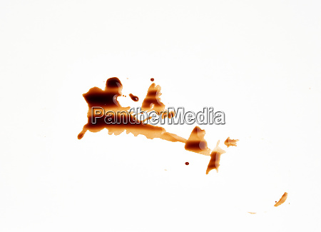 spilled black coffee on white paper