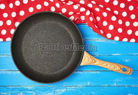 empty black round nonstick frying pan