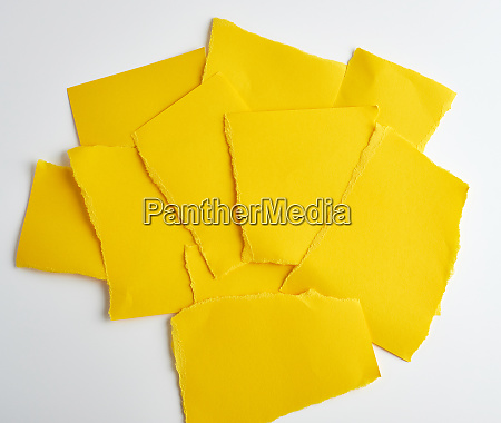 stack of yellow paper torn pieces