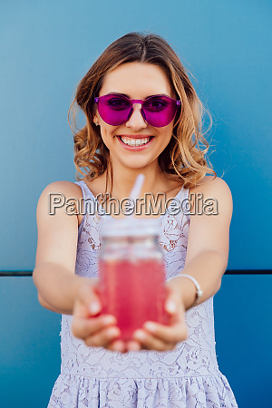happy girl holding a jar with