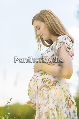 beautiful pregnant woman in white summer