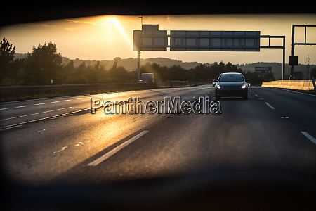 cars on a highway at sunset