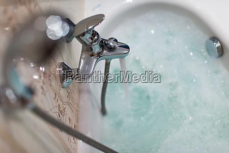 foamy hot bath in a modern