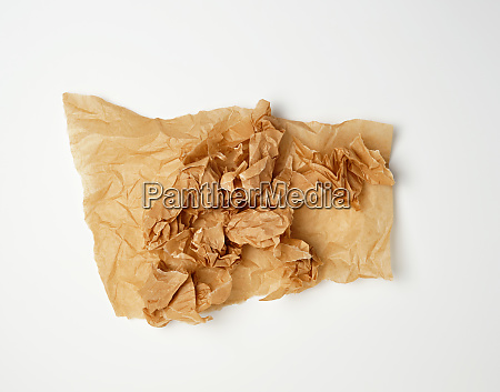 crumpled piece of brown paper sheet